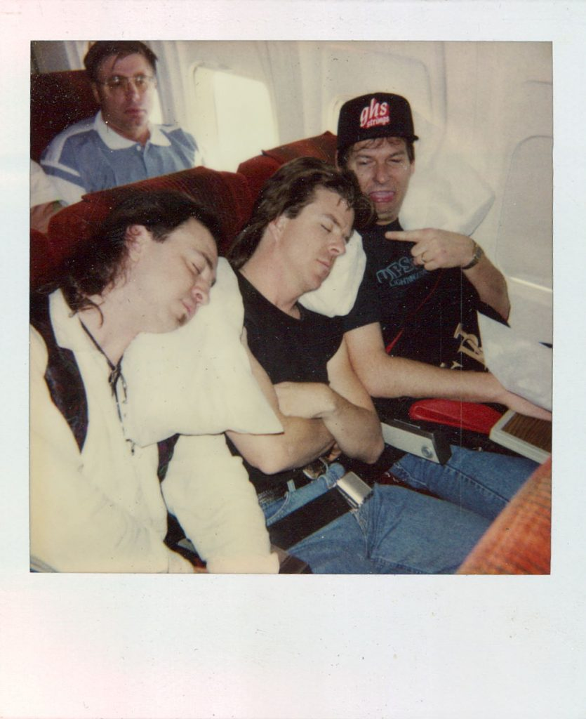 Sleeping on a plane. Photo courtesy of Tommy Shannon