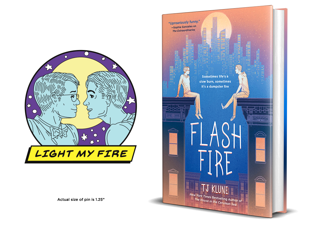 """Flash Fire by TJ Klune book jacket beside promotional enamel pin featuring the two figures on the cover within a circle with a box on the bottom that says """"Light My Fire"""""""